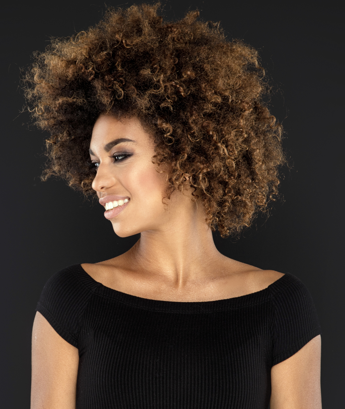 Portrait of girl with afro hairstyle.